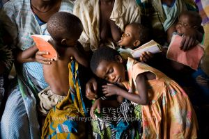 FAMILIES GATHER AFTER LONG WALK TO RURAL HEALTH CLINIC, MALAWI, AFRICA