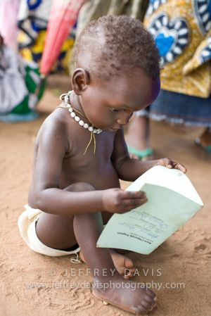 EXPLORING A HEALTH CARD, RURAL HEALTH CLINIC, MALAWI, AFRICA