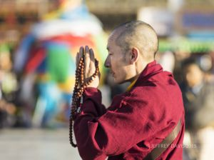PRAYER AT JOKHANG TEMPLE, LHASA, TIBET