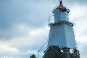 WET AND WINDY, LIGHTHOUSE, LOFTOTEN ISLAND, NORWAY