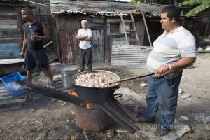 COOKING PORK, INNER COURTYARD, REGLIA, CUBA