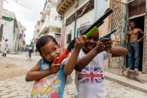 JOSE AND RYAN, AT PLAY AS SOLDIERS, OLD HAVANA, CUBA