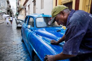DANIEL, CAR SANDER AND PAINTER, OLD HAVANA, CUBA