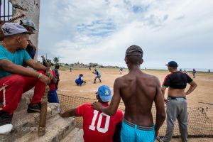 AT PLAY, COMMUNITY BASEBALL FIELD, COJIMA, CUBA