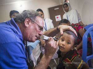 DR. EVAN BLOOM EXAMINES PATIENT, PRE-SURGERY REVIEW, HOPE HOSPITAL, COX'S BAZAR, BANGLADESH
