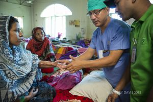 MOHAN TEACHES CRITICAL STEPS IN PHYSICAL THERAPY, HOPE HOSPITAL, COX'S BAZAR, BANGLADESH