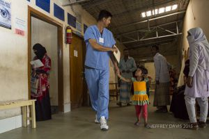 QUAZI, BURN CLINIC VOLUNTEER COORDINATOR, LEADS AZIDA INTO SURGERY, HOPE HOSPITAL, COX'S BAZAR, BANGLADESH