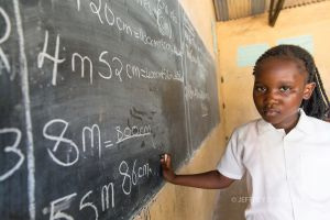 CHANDA, MASTERING MATH, 8 YEARS OLD, MFUWE SCHOOL, ZAMBIA