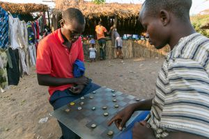 CHECKERS WITH BOTTLE CAPS, MFUWE, ZAMBIA