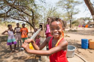 DEBBORAH, THE GIFT OF CLEAN WATER, KIFA VILLAGE, SOUTH LUANGO NATIONAL PARK, TANZANIA